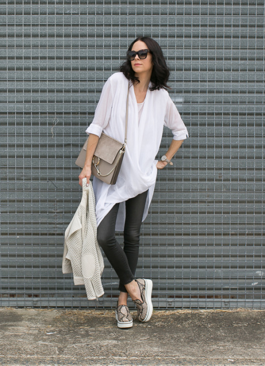 Keeping your outfit neutral is one of the best ways to generate a simple but sophisticated style like this one by Fiona Edwards. Pale tones of white, cream and beige, are key stepping stones to getting a gorgeous spring style. Jacket: Joie, Jeans: Frame, Top: Hunky Dory, Bag: Chloe, Shoes: Stella McCartney, Sunglasses: Celine.