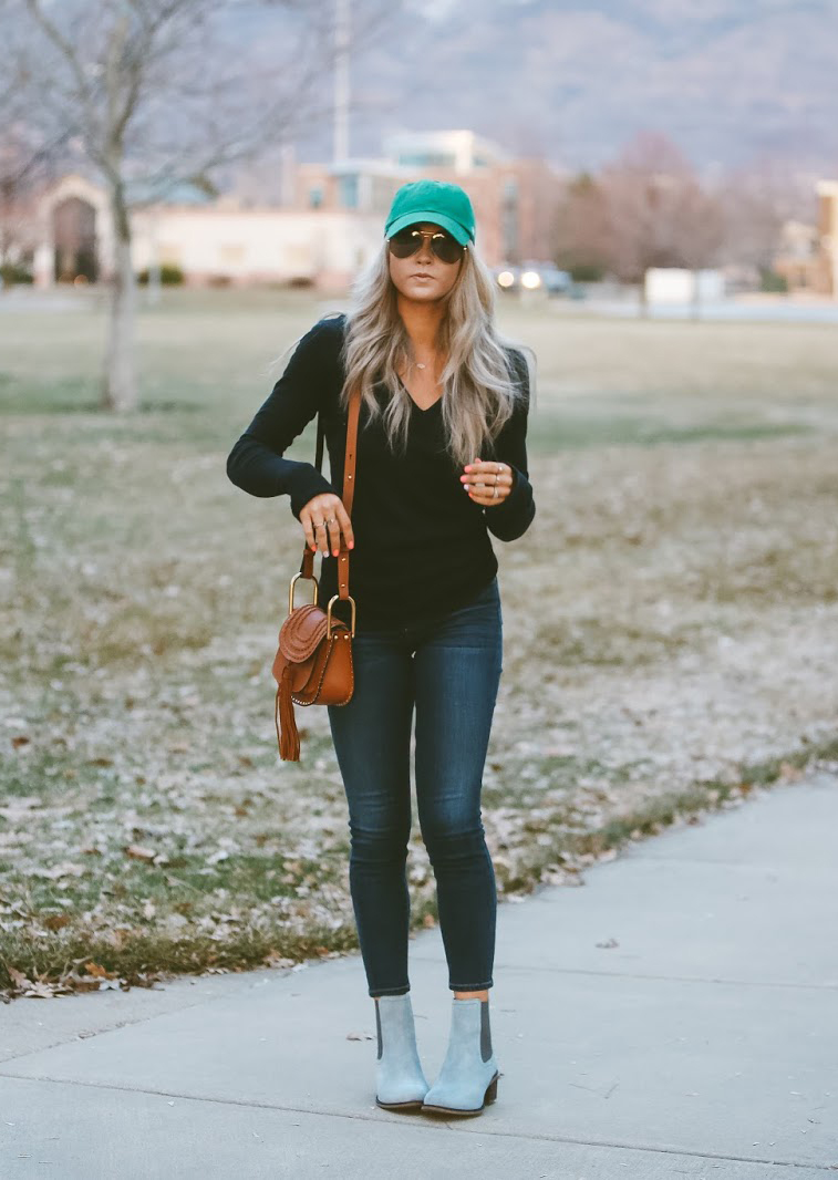 A statement baseball cap is a fabulous way to bring in the sping! This cute blue cap worn by Cara Loren matches excellently with her pastel blue Chelsea boots and denim jeans, creating a stylish spring look. Shoes: Hush Puppies, Top/Jeans: Shopbop.