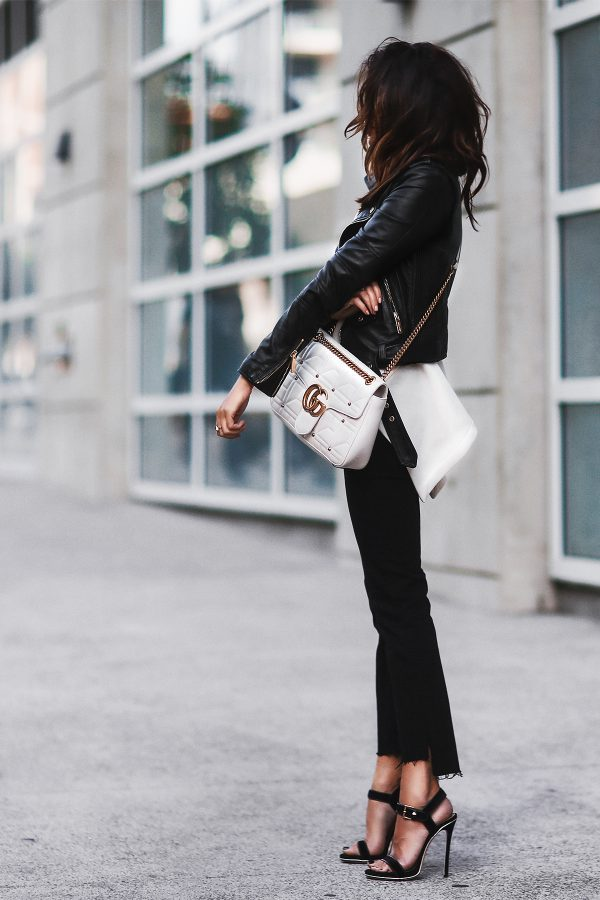 Erica Hoida is absolutely owning this leather jacket style, consisting of cigarette trousers, incredible stilettos and a cross body bag by Gucci. This is a look which will simply never go out of fashion! Jacket/Shoes: Dsquared2, Sweatshirt: Marni, Jeans: Frame Denim, Bag: Gucci.