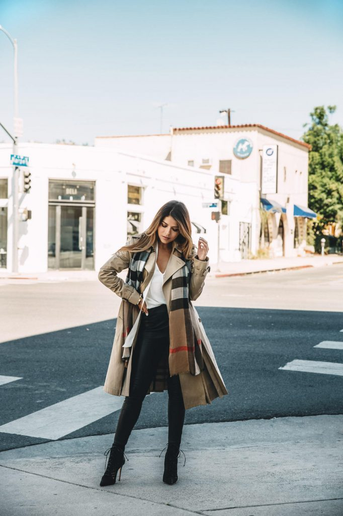 Pam Hetlinger looks utterly elegant in this classic Burberry trench coat, worn simply with leather leggings and a pair of heeled boots. We love this simplistic but sophisticated fall style.   Trench: Burberry.