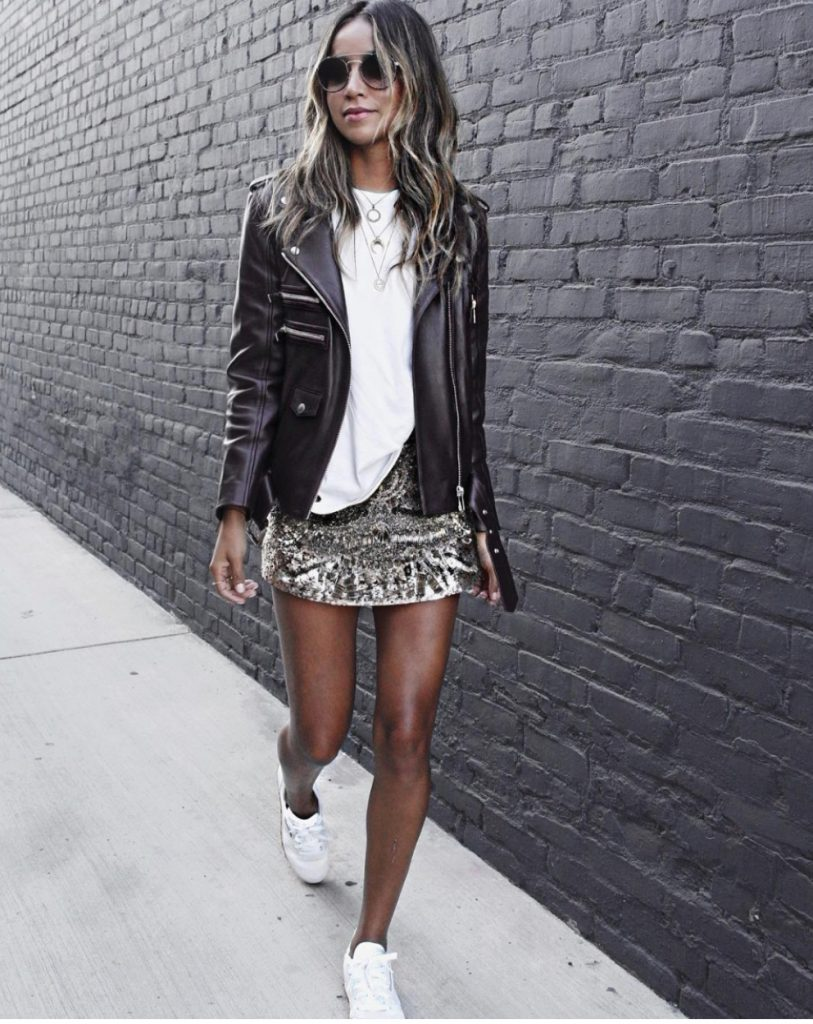 Julie Sarinana adds instant glamour to this outfit by adding a fitted leather jacket, with metallic detailing for an alternative edge. Wear a jacket such as this with a statement skirt and white tee to steal this look!  Sneakers: Reebok.