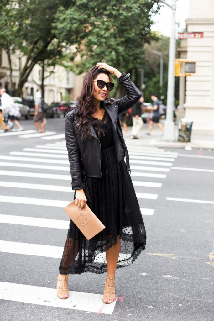 Kat Tanita is absolutely stunning in this sheer lace dress, paired with a leather jacket and sandals for a glamorous evening look. Wear this look with neutral accessories to capture this aesthetic!   Dress: Zimmermann, Jacket: Banana Republic, Sandals: Valentino, Clutch: Gucci.