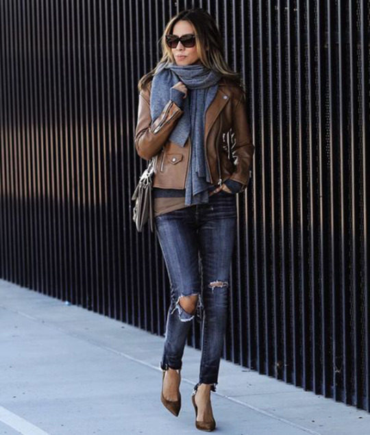 Sasha Simon is sleek and sophisticated in this leather jacket look, pairing this brown piece with distressed denim jeans and heels for a glamorous take on an everyday style! Brands not specified.