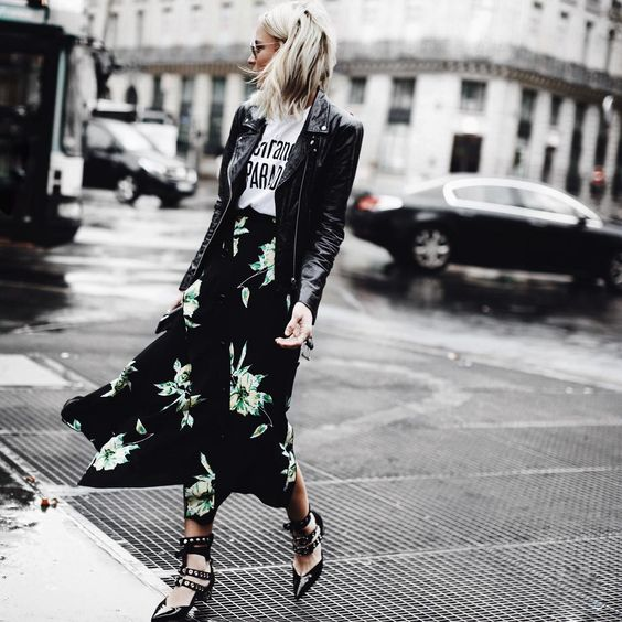 Mary Seng is rocking a classic black leather jacket, worn with a graphic slogan tee and a patterned maxi skirt. Mary completes this edgy style by wearing strappy studded sandals.   Jacket: Veda, Skirt: Proenza Schouler, Shoes: Mr Self Portrait.