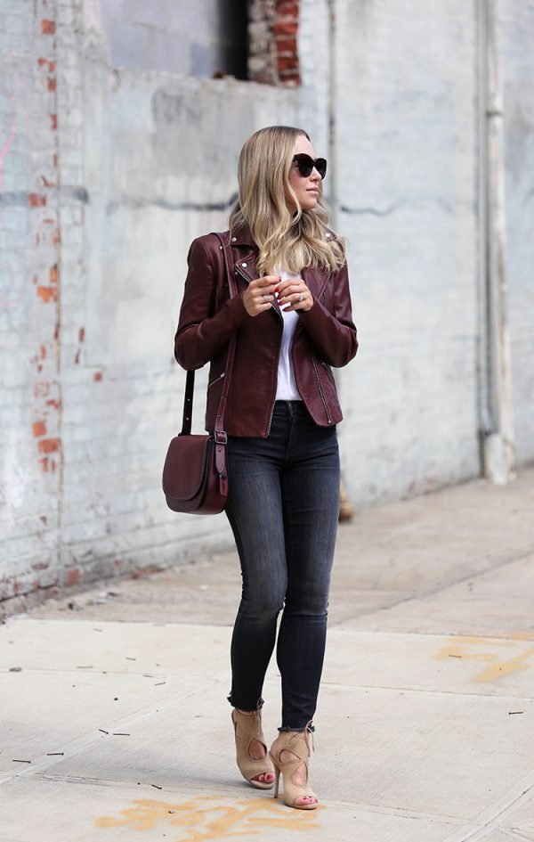 Helena Glazer is keeping it chic and simple in this gorgeous autumnal style, consisting of a maroon leather jacket paired with black denim jeans and a plain white tee. This outfit oozes elegance when worn with heels, but could equally be worn with sneakers for a more casual aesthetic. Leather Jacket: Veda, Denim: Elliott, Shoes: Aquazzura, Bag: Coach.