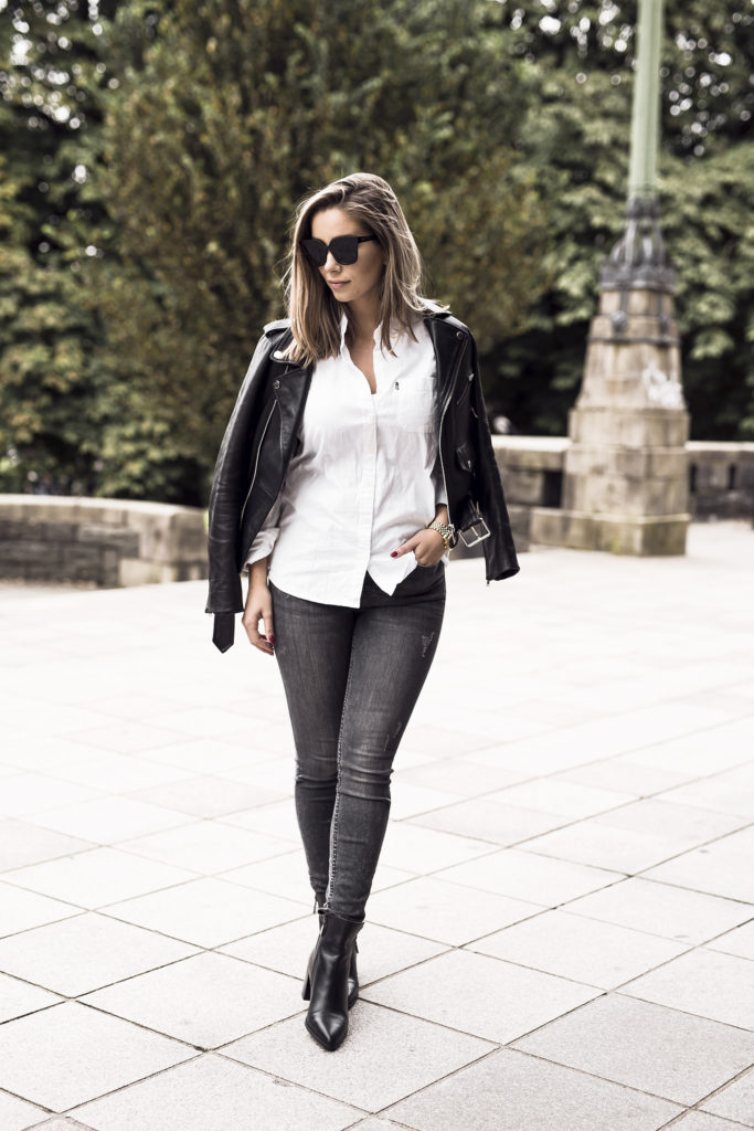 Emilie Tømmerberg's leather jacket style is an absolute classic. The combination of a white shirt, black jeans and biker jacket creates the ultimate androgynous chic look, and paired with Chelsea boots is a great everyday style.   Outfit: Zara.