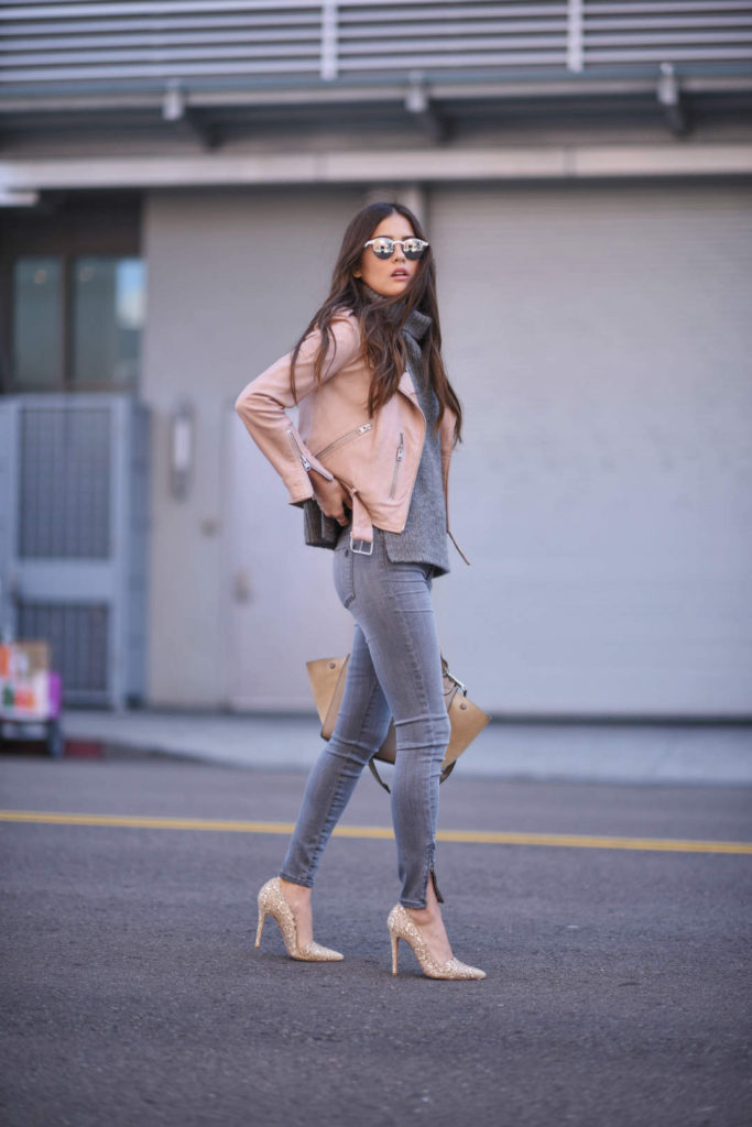 Leather jackets don't only look good in classic black! A blush pink jacket like this one worn by Paola Alberdi will look a treat paired with skinny jeans and a simple grey knit sweater to create the ultimate spring style!  Jacket: All Saints, Sweater: Barney's New York, Jeans: Shoptiques.