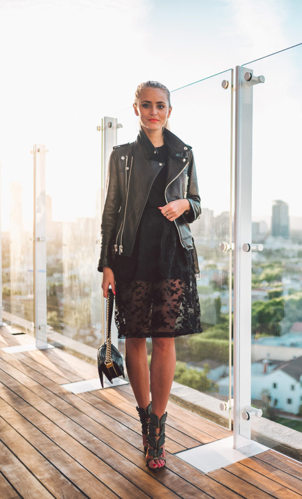 A leather jacket is the perfect medium between formal and casual. Janni Deler wears this stylish piece over a gorgeous sheer lace dress, creating a sophisticated style which is not too smart for the streets!   Jacket: LXLS, Top: Gina Tricot, Skirt: Spain, Bag: Chanel, Shoes: Guiseppe Zanotti.