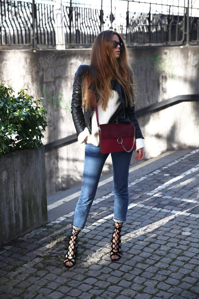 A leather jacket will look ultra suave worn with classic knitwear and blue denim. Josefin Ekström is rocking a trendy but casual style here, jazzing up the look with a pair of badass lace up sandals!   Jacket: Zara, Knit: Gina Tricot, Jeans: Levis.