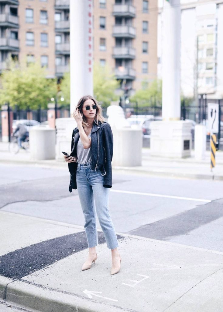 Jill Lansky is wearing a gorgeous Aritzia leather jacket over a simple grey V neck tee and jeans for this cute spring look. Try to create a more retro style by throwing in a pair of classic shades and kitten heels!  Jacket: Aritzia.