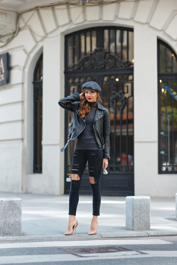 Leather jackets will always work with an all black style. Larisa Costea wears this jacket over a dark grey turtleneck sweater and a pair of distressed black jeans. Nude heels are also a great way to keep the look simple while also adding a touch of femininity. Turtleneck/Jacket: Zara, Jeans: Shein, Stilettos: Kurt Geiger.