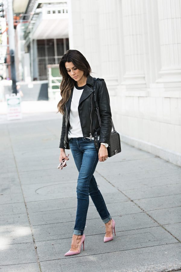 A black leather jacket is the perfect way to spruce up a casual t-shirt and jeans look! By wearing a jacket like this over a baseball tee, Christine Andrew has captured an all-American style which is perfect for everyday wear. Jacket: AllSaints, Tee: ILY Couture, Jeans: Nordstrom.