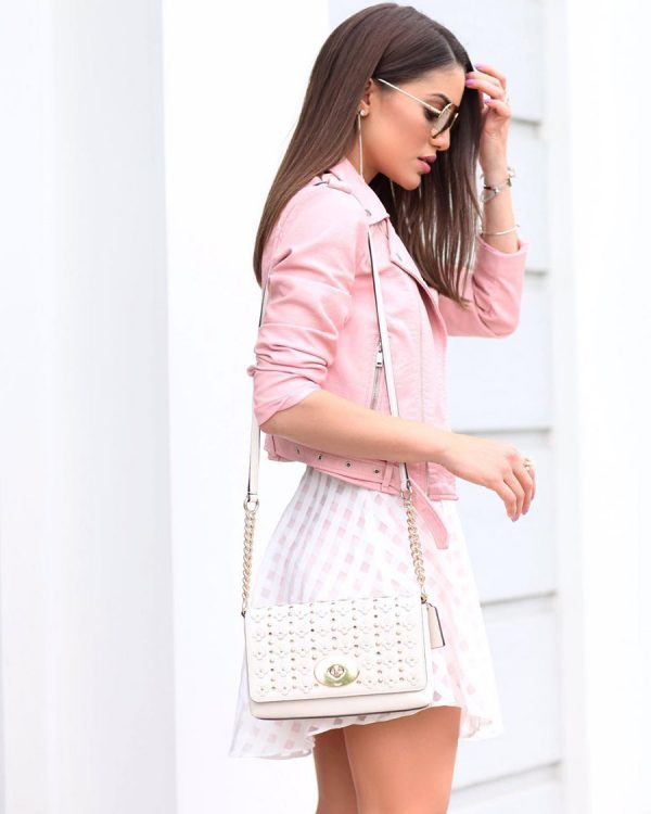 This cropped pink jacket is a wonderful alternative to a classic black biker jacket. Camila Coelho is wearing this piece with a super cute gingham mini skirt, creating a playful summer style which we would love to copy! Dress: Lovers and Friend, Jacket: Zara, Sandals: Aquazurra.