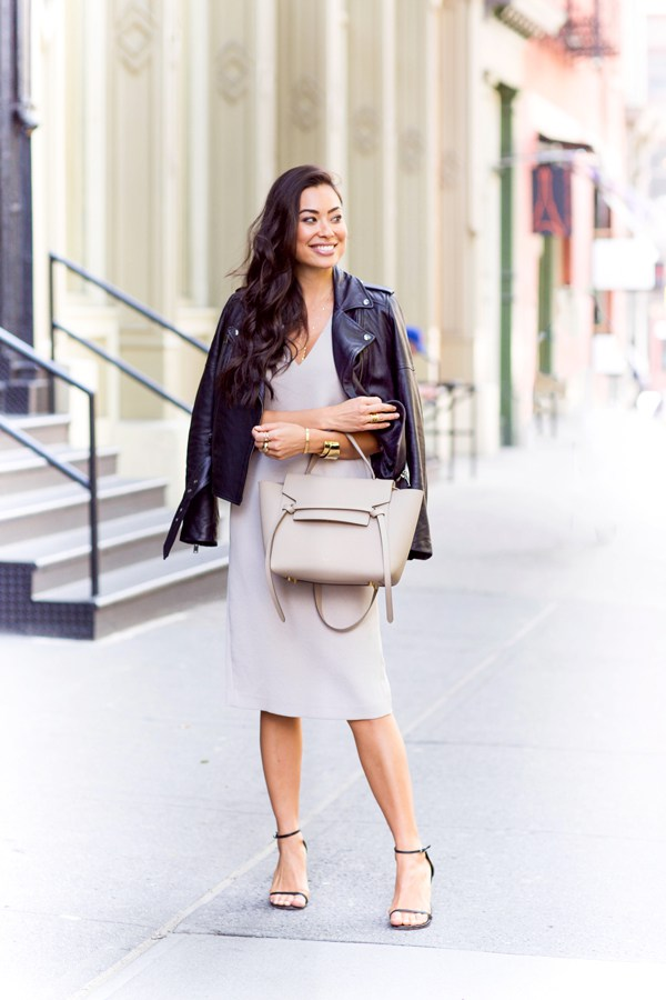 Wondering what to wear with your leather jacket? Look no further than Kat Tanita's fabulous example, and try pairing a gorgeous plunge neck dress with a leather jacket, heels and neutral accessories.   Jacket/Heels: Banana Republic, Dress: Aritzia, Bag: Celine.