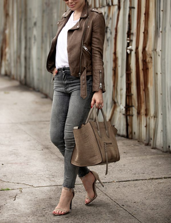 Helena Glazer is decisively rocking the brown leather jacket look; pairing this one with a simple white tee and distressed acid wash skinny jeans for an edgy chic style. Wear this look with either heels or sneakers for an authentic summer style.   Leather Jacket: All Saints, Tee: CHRLDR, Denim: Mother, Shoes: Schutz, Bag: Celine.