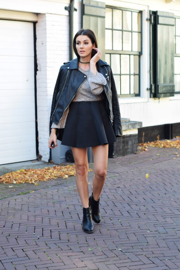 A leather jacket is the perfect match to a classic A line skirt and sweater combination. Mary Josephine wears this look with Chelsea boots and a simple choker for instant chic. Shoes: Comegetfashion, Skirt/Top: Choies, Jacket: Loavies.