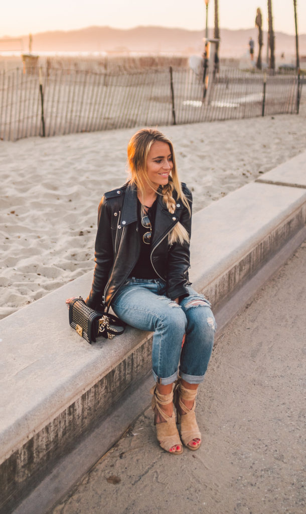Janni Deler is wearing a classic leather biker jacket here, bringing back a retro fifties style which is perfect for an edgy and alternative look! Ripped jeans are also an essential if you want to really nail this style.   Brands not specified.