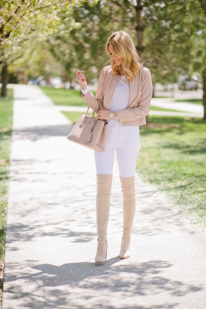 Emily Jackson is looking super cute in this pastel coloured outfit, dominated by a pair of blush pink thigh high boots and a matching bomber jacket and bag. White and pink will always make a great combination, especially in spring!  Boots: Stuart Weitzman, Jeans/Top: Rag and Bone, Jacket: Rebecca Taylor.