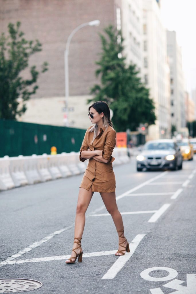 If you're looking for a super fresh spring style, why not try the shirt dress trend? Danielle Bernstein shows us how authentically cute this look can be, in a rustic style mini dress worn with gladiator platforms for a stylish overall outfit.  Brands not specified.