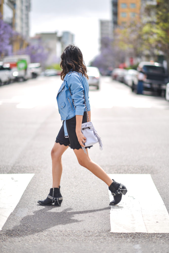 For a super fresh and bold spring style, try copying Francesca Felix' aesthetic by pairing a pastel coloured leather jacket with a little black dress and studded ankle boots. This style is an awesome twist on the traditional leather jacket look!  Dress: Show Me Your Mumu, Jacket: Shop Avenu, Boots: Spell And The Gypsy.
