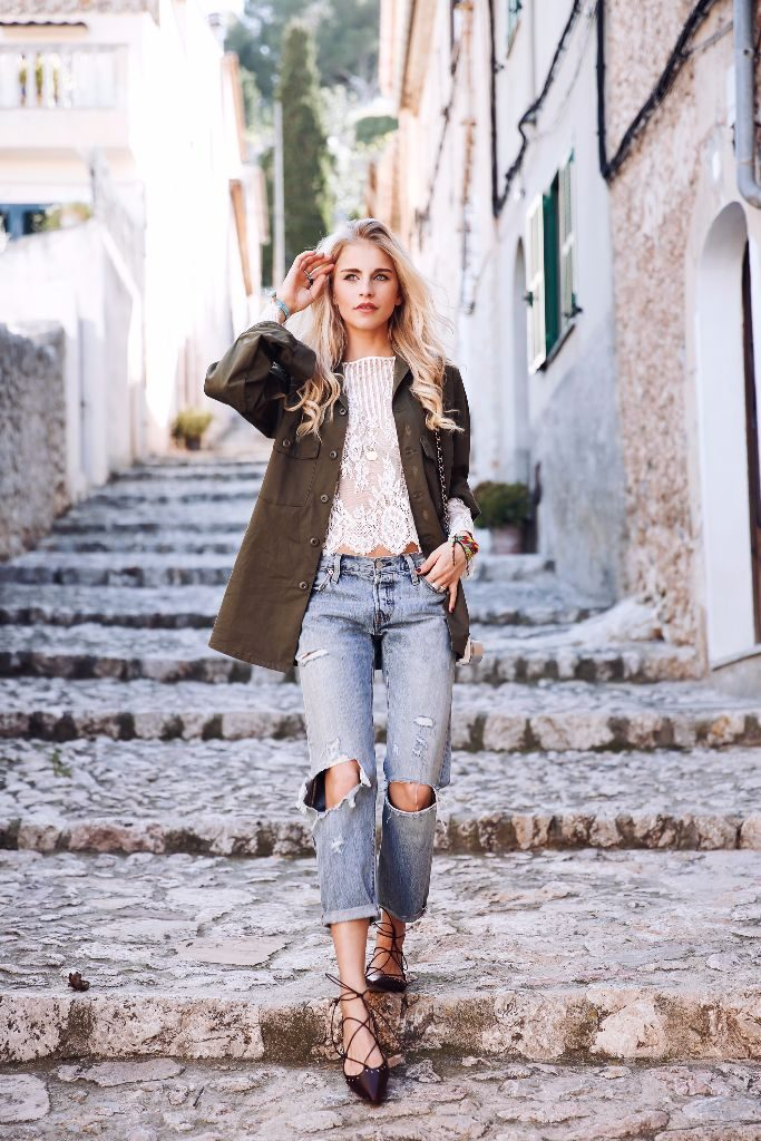 Wearing a pair of destroyed denim jeans is a sure-fire way to achieve an edgy spring style! Pairing jeans with strappy pointed flats and an oversized khaki jacket, Caroline Daur has created a fun and alternative look to die for!   Top: Guess, Jacket: Vintage, Jeans: Levi's, Shoes: Massimo Dutti.