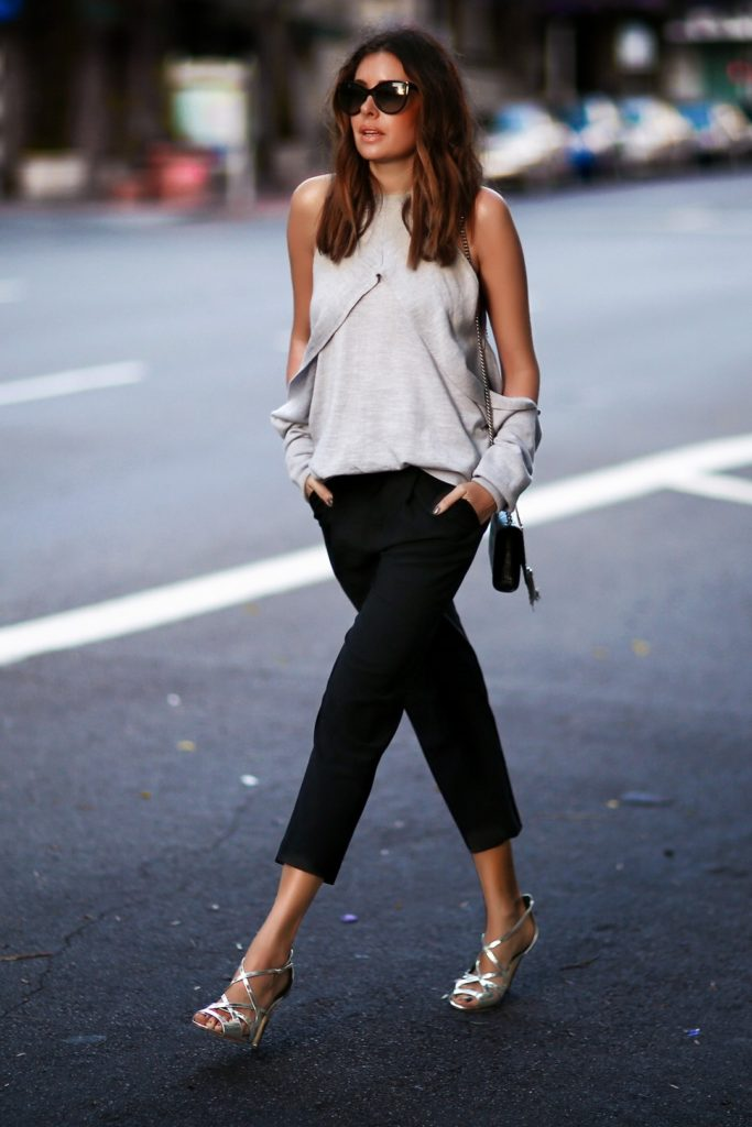 If you're looking for a more sophisticated style, take some notes from Erica Hoida and wear a pair of stylish cropped cigarette trousers with simple metallic heels and an off the shoulder halter neck top.  Top: Dion Lee, Trousers: Nili Lotan, Shoes: Rupert Sanderson, Bag: Saint Laurent.