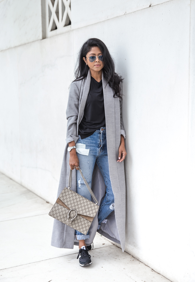 For those cooler days, why not style up a simple tshirt and jeans outfit with a maxi coat! This marl grey number worn by Sheryl Luke is a perfect match to this overall look, adding glamour and sophistication!   Top: TYLR, Coat: BNKR, Jeans: Shopbop.