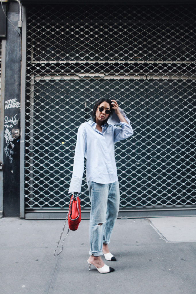 We are absolutely loving Serena Goh's super cool twist on a classic androgynous look! By pairing a pale blue button up with statement white heels and a crimson handbag, Serena has totally revitalised this tomboy style!  Jeans: Frame Denim, Shirt: Concept, Bag: Stella McCartney.