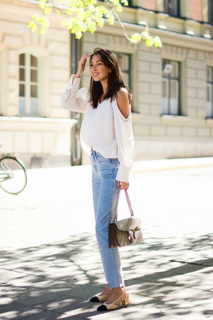 Outfits with cut out detailing, like this shoulderless top, will always give you a sexy, sophisticated style. Felicia Akerstrom has chosen to pair this gorgeous white top with a pair of vintage style straight leg jeans for a cute and casual spring style.   Top: Gina Triot, Denim: H&M, Shoes: Chanel, Bag: Gucci.