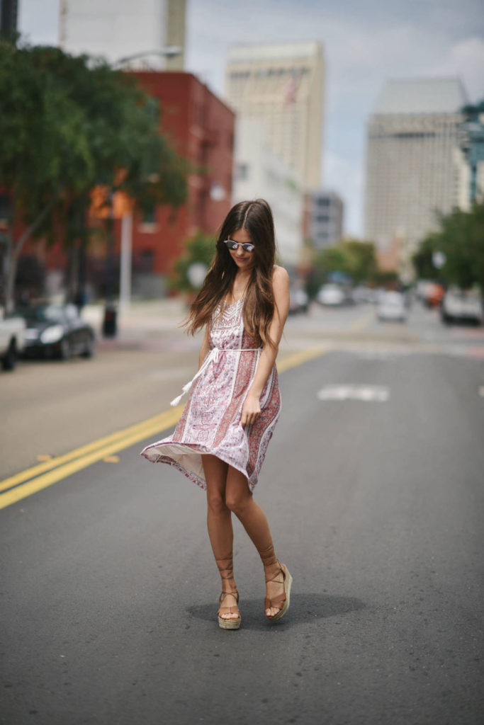 Gypsy print dresses are a winning trend every year! Paola Alberdi is looking cute and flirty in this traditional printed dress with waist tie detailing. Wear the look with a pair of nude wedge heels to steal Paola's style!  Dress: Lucky Brand, Shoes: Nine West.