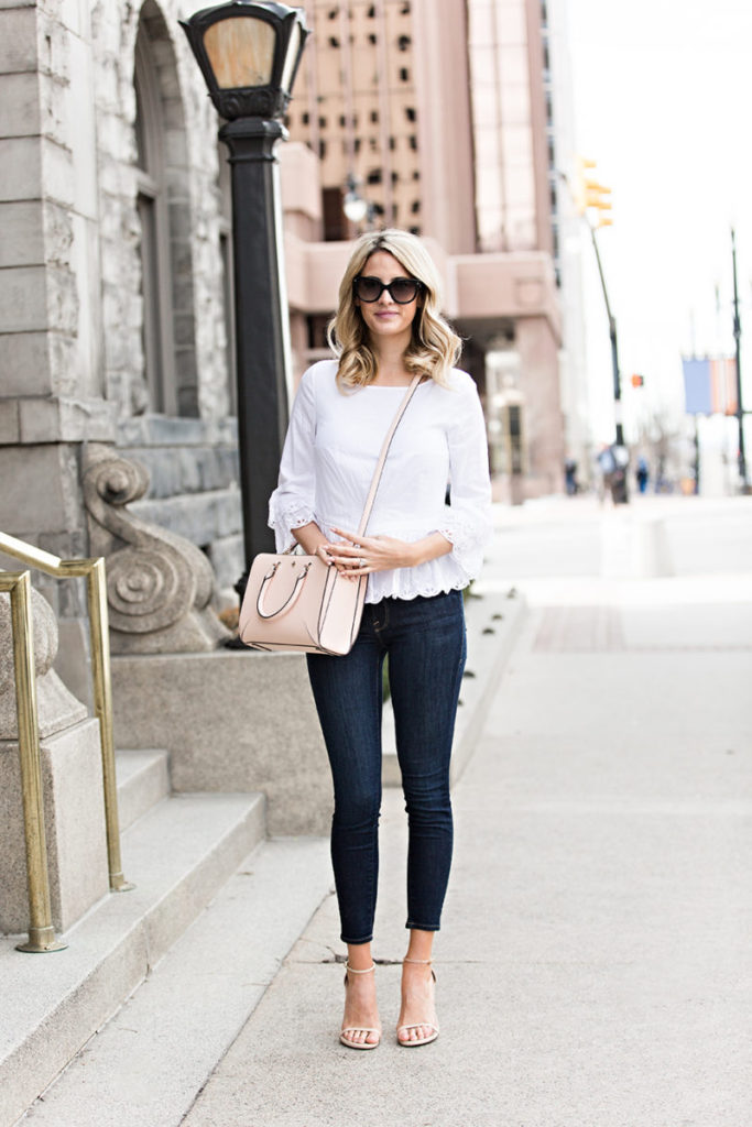 Emily Jackson has kept her cute spring outfit simple and effective by wearing minimal colours and choosing pastel accessories. This outfit – consisting of a pretty white blouse with denim jeans and sandals – is perfect for everyday spring sophistication.   Top/Bag: Tory Burch, Jeans: Frame, Sandals: Stuart Weitzman.