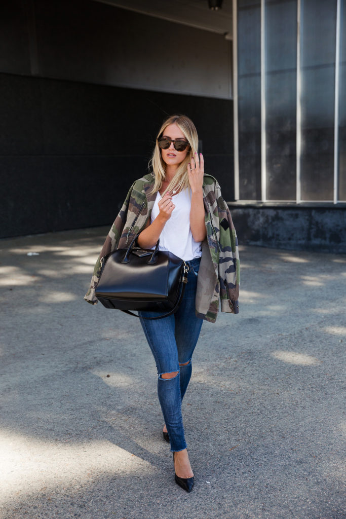 Kristin Sundberg is rocking an edgy and semi-androgynous style here in a white tee, distressed skinny jeans and an oversized camouflage jacket. This look is effortlessly simple and yet never fails to look cute!   Jeans: Lindex, Jacket: NA-KD, Shoes: Zara, Bag: Givenchy.
