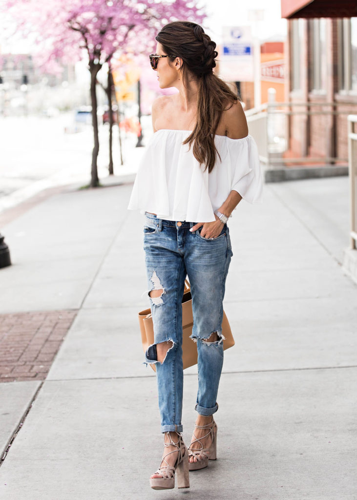 Floaty off the shoulder tops are a must have this spring! Christine Andrew is looking elegant and mature in this wonderful piece from ILY couture, which she has paired with distressed denim jeans to get that edge you crave!   Top/Jeans: ILY Couture.