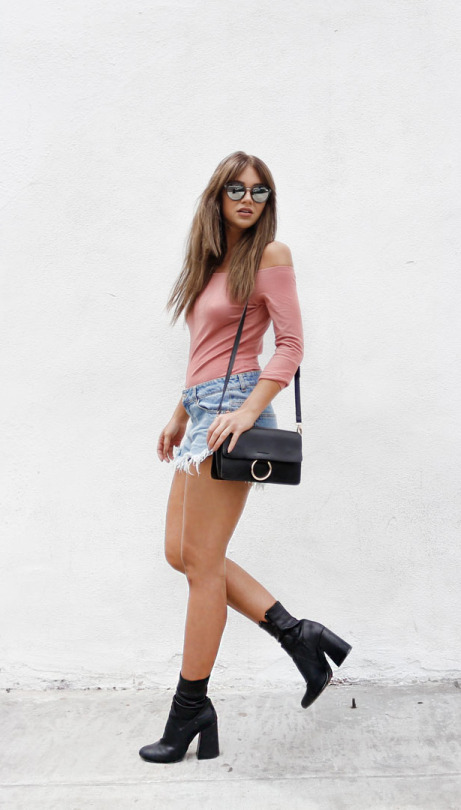 A simple pair of fringed denim shorts will always afford you an easy and achievable summer style! Madelene Billman is looking super cute in these shorts from NLY, which she has paired with a plain off the shoulder top for a simple but effective look!  Top/Boots: NLY Trend, Shorts: Levis, Bag: Lindex.