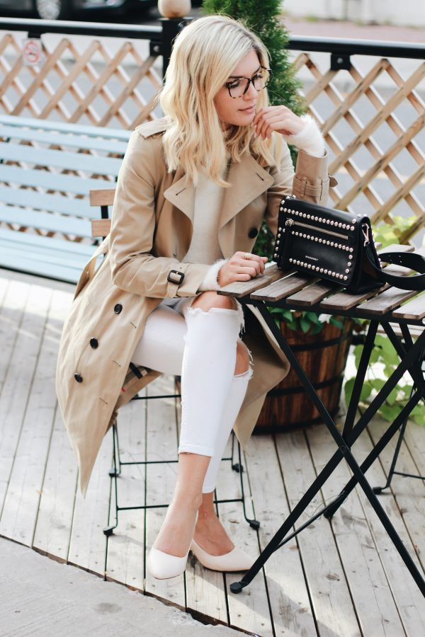 The trench coat trend has never been hotter! Venice Greel wears this stunning beige coat over white jeans and a white tee to create an overall neutral look which we adore. Outfit: Burberry.