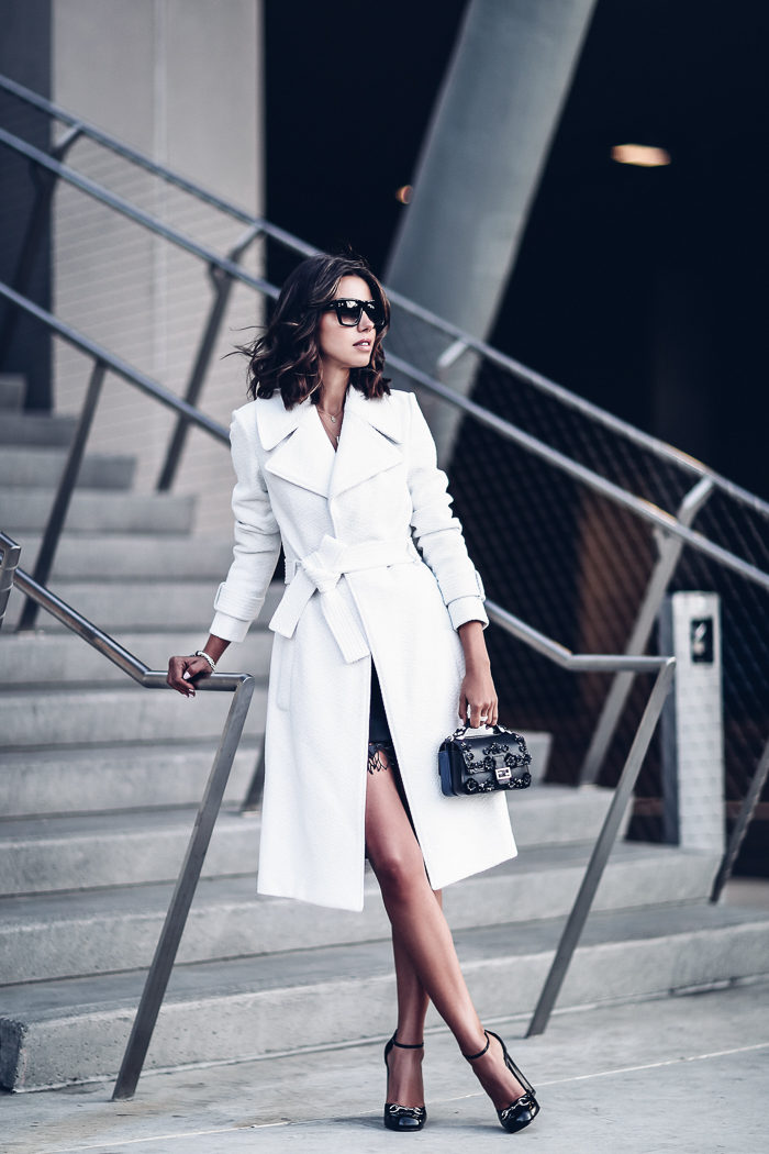 A bright white trench is an absolute statement, adding endless glamour to any of your outfits. Wear this piece with a skirt, trousers, or a dress, and be sure to get this wonderful, elegant aesthetic whatever you choose! Via Annabelle Fleur. Coat: A.L.C Richard, Dress: Jamie, Heels: Gucci.