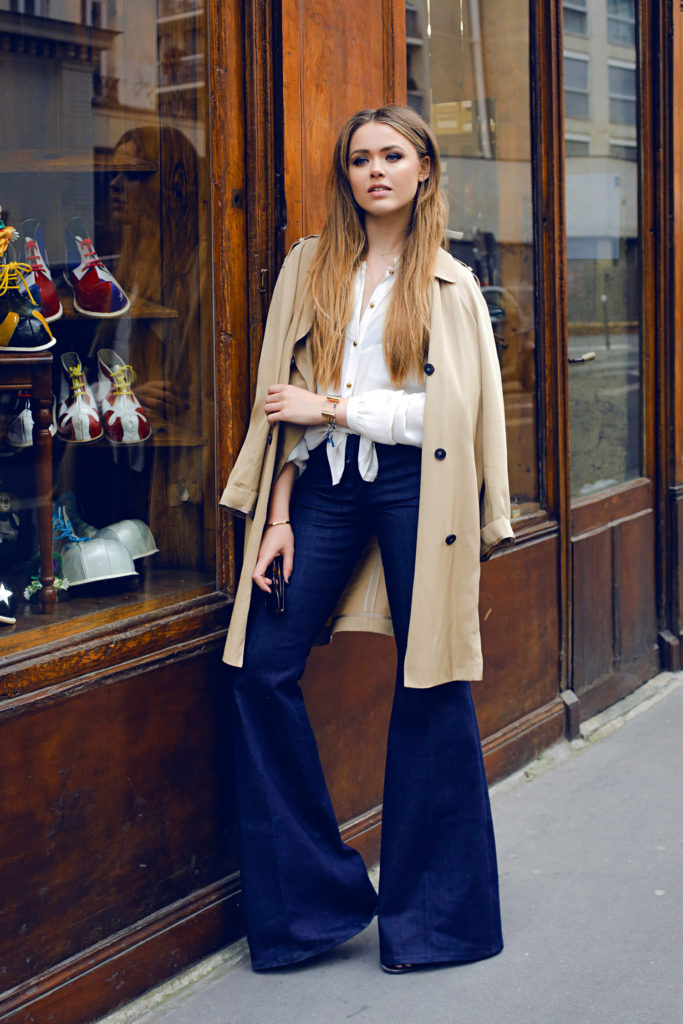 Another foolproof way to wear the beige trench style is to pair it with statement jeans like Kristina Bazan. Whether you go for high waisted, distressed, or flared jeans, be sure to make a statement!   Jeans: 7 For All Mankind, Coat: Topshop, Top: H&M.