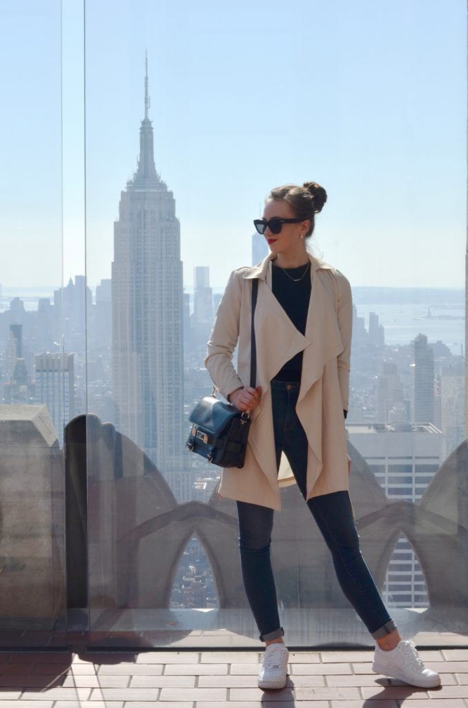 'There is almost nothing sleeker than a black and cream combination. Barbora Ondrackova looks ready to hit the streets in this gorgeous floaty trench coat, worn over a simple black sweater with denim jeans and sneakers.   Sweater: Proenza Schouler, Jeans: Acne, Coat: Fashionpills, Sneakers: Nike.