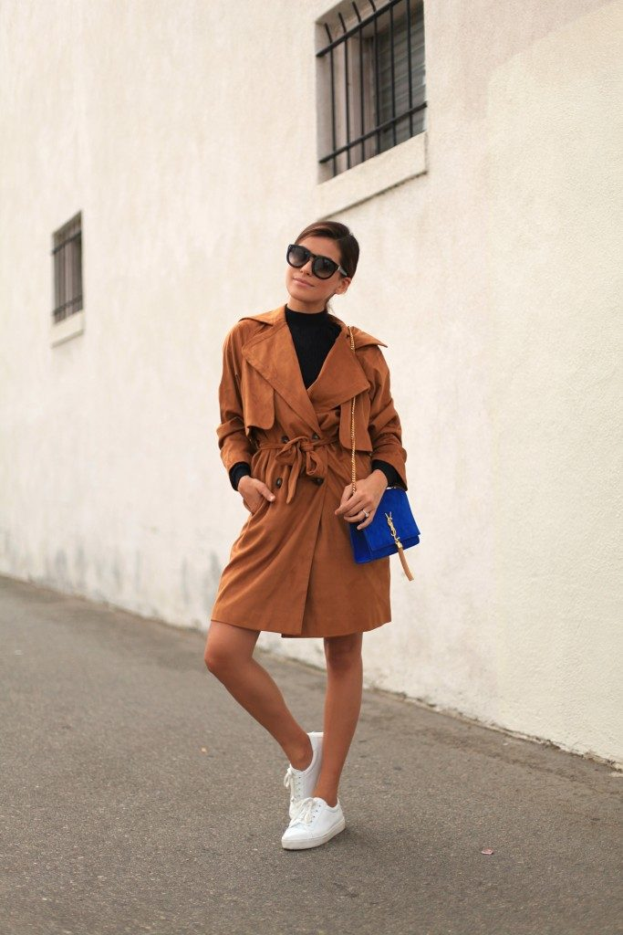 Sazan Barzani shows us a whole new way of wearing the trench coat style here; in head to toe seventies suede! This unique trench looks utterly striking worn with a simple black tee and a pair of white sneakers.   Coat/Top/Sneakers: Topshop, Bag: YSL.