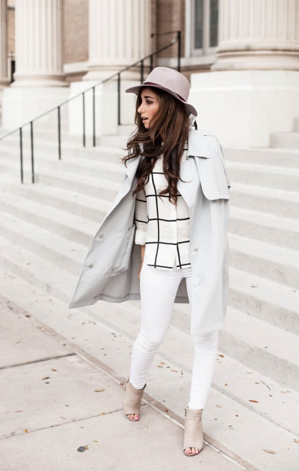 An all-white outfit will be utterly transformed by a classic white trench! Jessi Afshin looks ready for spring in this beautiful combination of white jeans, nude sandals, and a retro style fedora. Blouse: Sheinside, Coat: Chicwish, Hat: Nordstrom, Shoes: Dolce Vita.