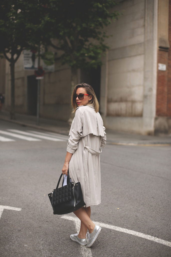 A trench coat can absolutely form the basis to your outfit. Priscila Betancort looks ultra stylish in this beige coat from Zara, paired simply with metallic canvas sneakers and a leather tote.   Trench/Shoes: Zara.