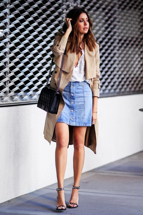 Erica Hoida has created a gorgeous spring style here, pairing a classic beige trench with a button front denim skirt and a sexy plunge neck tee. Wear this look with a pair of heeled sandals to steal Erica's style! Trench: O'2nd, Shirt: Free People, Skirt: Paige Denim, Shoes: Proenza Schouler, Bag: Chanel.