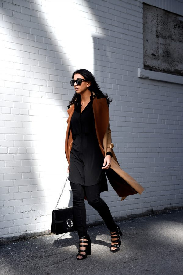 One style you simply must try is wearing a camel coloured trench over an otherwise all black outfit, like Kayla Seah here. All-black is always sleek and sophisticated, and the camel coat just adds that contrast you need for true glam! Trench Coat: Few Moda, Shirt Dress: Topshop, Jeans: Paige, Heels: Toni