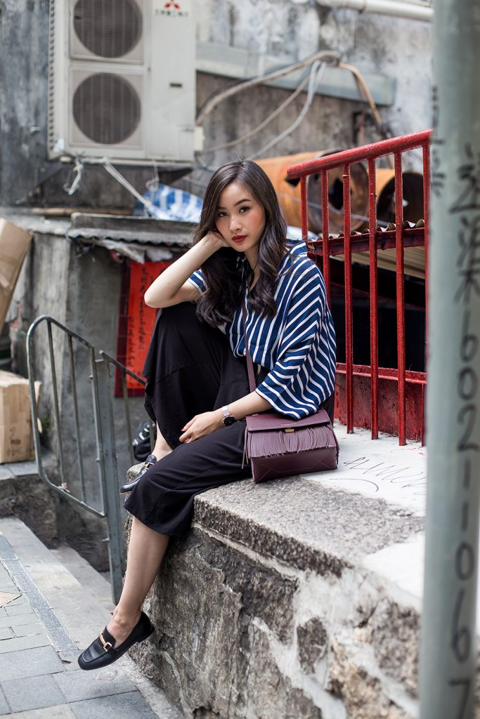 A pinstripe blouse will look great paired with culottes and loafers, as demonstrated by Levi Nguyen. This look is sophisticated yet simple, and will always afford you a classy overall style.  Jumpsuit: Zelle Studio, Bag: H&M, Loafers: Charles & Keith.