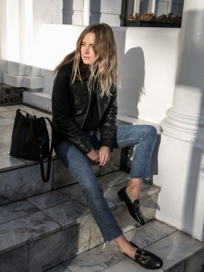 Lucy Williams shows us another gorgeous loafer style here, pairing this classic leather pair with frayed denim jeans and a matching leather jacket. This look is a must-try for anyone who wants an edgy loafer vibe! Jacket: Sandro, Knit: Zoe Jordan, Jeans: Vintage Levis via Reformation, Shoes: Gucci, Bag: Mansur Gavriel.