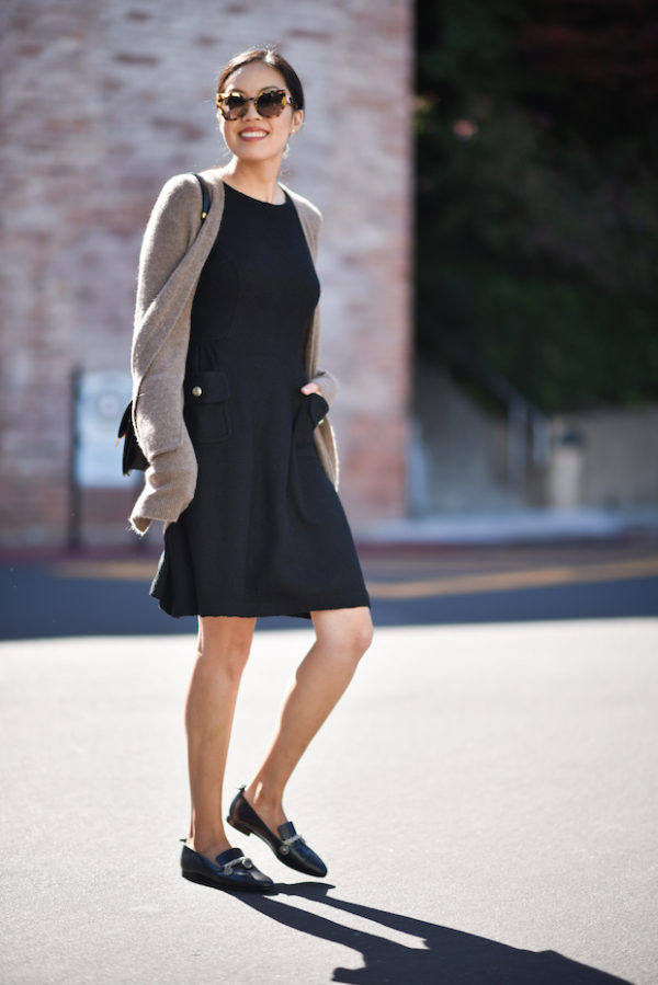 Ann Taylor rocks a gorgeously simple style here in a little black dress, knitted cardigan, and a pair of black Chanel loafers. An outfit such as this is the ideal fall look because it is both casual and sophisticated, so why not give it a try? Cardigan: Madewell, Dress: St. John, Loafers: Chanel, Bag: Celine.