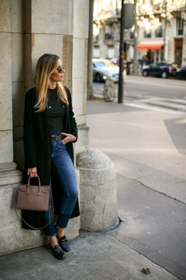 Manon Durst is rocking this super chic loafer style, consisting of a bottle green maxi coat, high waisted cropped jeans, and a plain tee. This kind of style goes ideally with loafers to create an understated yet sophisticated aesthetic. Coat: Maje, Jeans: Anine Bing, Tee: Zara, Bag: Saint Laurent, Shoes: Gucci.