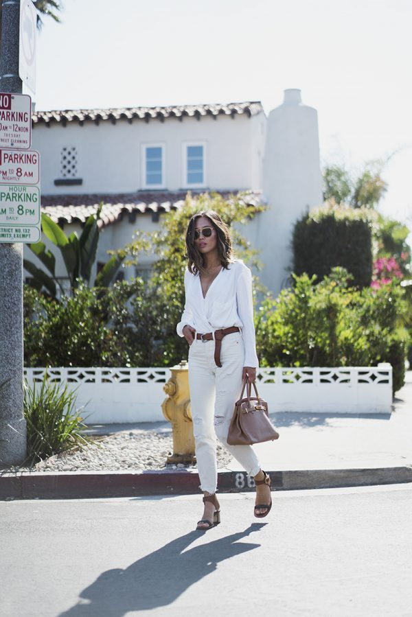 Go all out this September and give the all-white look a try! Aimee Song demonstrates just how glamorous this style can be, pairing distressed white jeans with a plunging V neck top. Bring this look together with a leather belt to copy this awesome look. Blouse: Helmut Lang, Belt: Mango, Jeans: Levis, Sandals: Celine, Bag: Hermes Birkin.