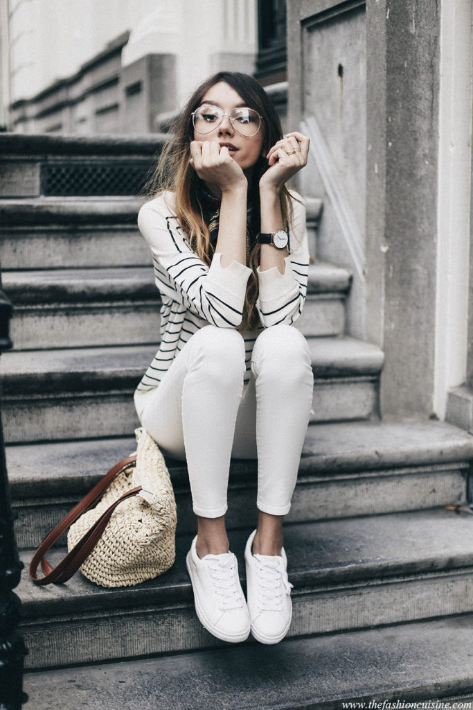 Beatrice Gutu is a vision in this adorable preppy style, consisting of a striped sweater, white jeans, and matching white sneakers. Accessorise with neutral colours to get this authentic sailor girl look!  Outfit: Marks & Spencer's.