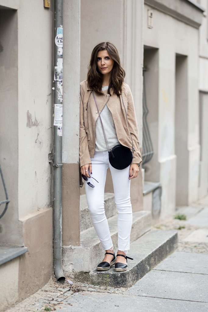 Break up an all white look with a splash of cream or beige, like Valerie Husemann has in this super cute jacket. For the perfect finish to this style, wear closed toe sandals and a cross body bag.   Jacket: Edited the Label, Jeans: Zara, Shirt: Sincerely Jules, Shoes: Zara.